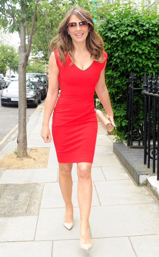 Elizabeth Hurley most definitely turned heads in a figure-hugging red dress paired with chic semi-rimless aviators! Can you say bombshell?!