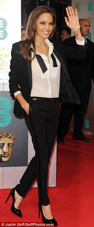 Man, I feel like a woman: Angelina Jolie in YSL, black blazer, a pair of loose black trousers and black stiletto heels