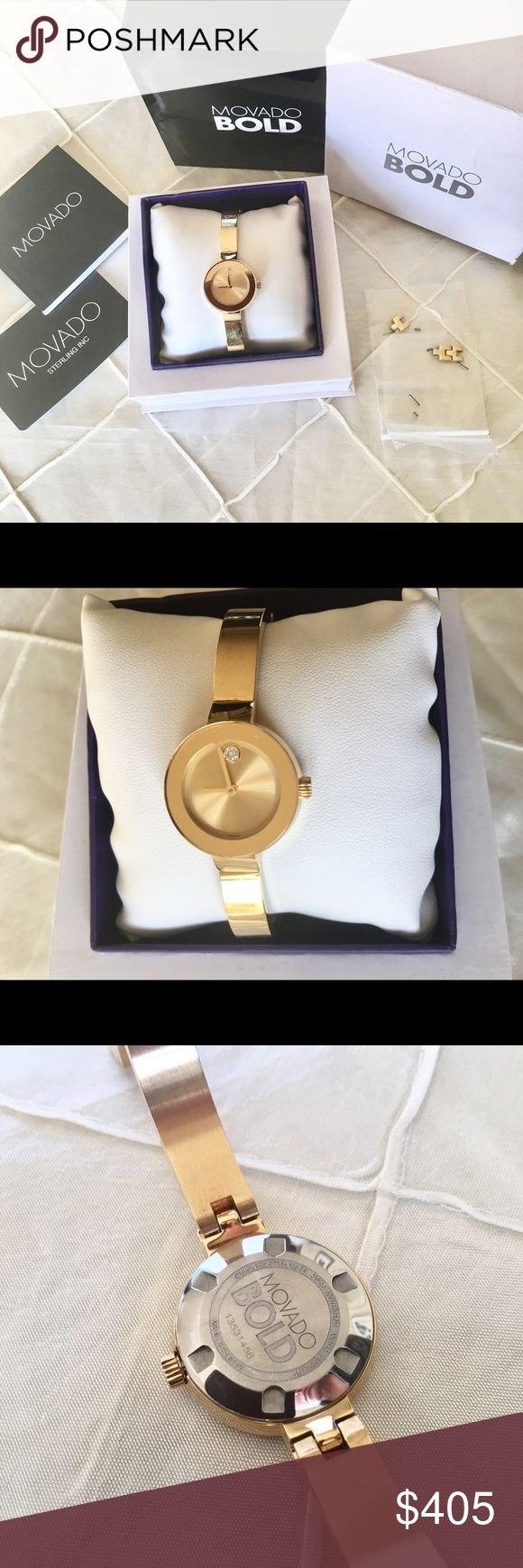 Movado BOLD yellow gold women's watch Movado BOLD watch, 25 mm yellow gold ion-plated stainless steel case, K1 crystal with a ring of highly reflective yellow gold-toned metallization, yellow gold-toned sunray dial with clear crystal-set dot and yellow gold-toned hands, yellow gold ion-plated stainless steel bangle-style bracelet with back sizing links and jewelry clasp.  Worn less than a handful of times, band in brand new condition. Pristine watch face and dial. Original links, packaging…