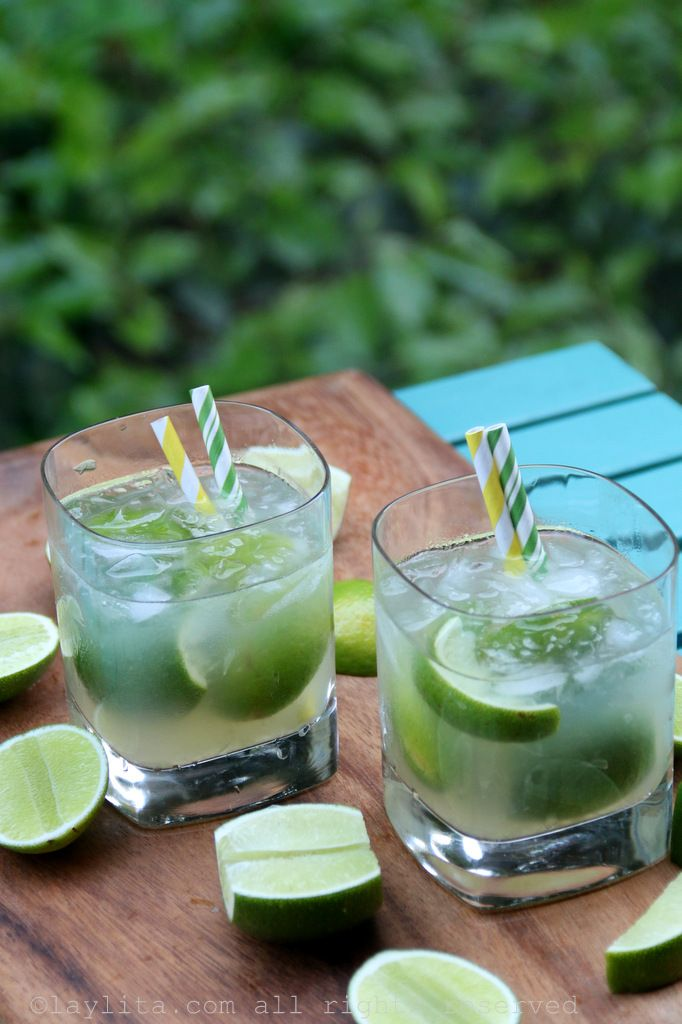 Easy recipe to prepare traditional Brazilian caipirinha cocktails, made with limes, sugar, cachaca rum liquor, and crushed ice.