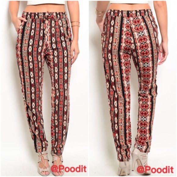 tribal print pants sz XS S M L Love these tribal print pants  Gathered waist with adjustable self tie  Hidden side pockets  Straight leg fit  Baggy style  Sz XS  Elastic waist 24-26 Hips 30-32 SMALL elastic waist 26-28 hips 32-34 MEDIUM elastic waist 28-30 hips 34-36 LARGE elastic waist 30-32 hips 36-38   Inseam 30 for all  Total length top to bottom 39  NWOT  Please compare your measurements as for all sales are final Boutique label Pants Straight Leg
