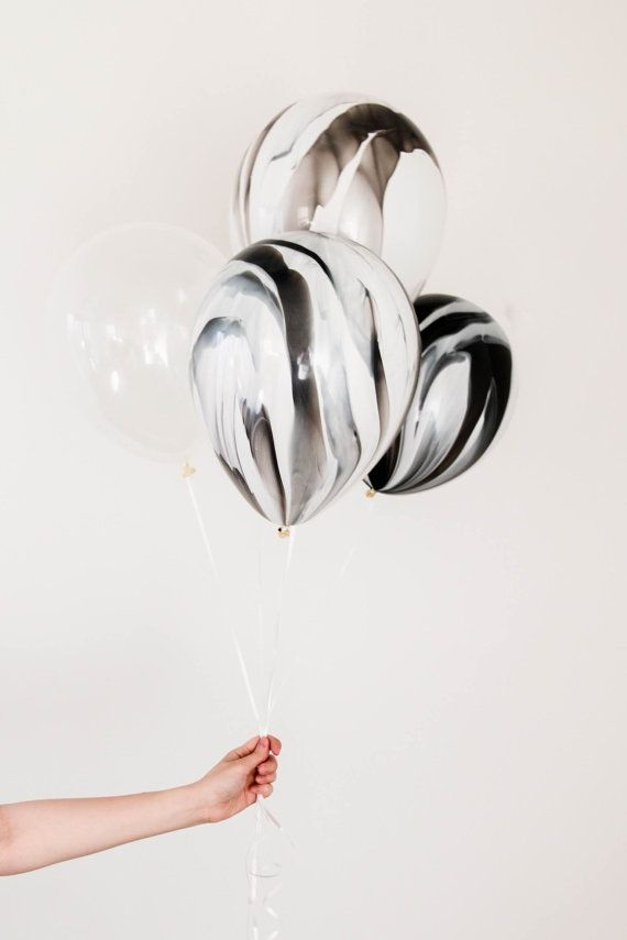 click on ask a question - ask for a special order of 20 of these black and white marble balloons or how ever many you would like.  They only appear to be doing bundles and I have tons of clear and black/white is way cheaper to buy in bulk.
