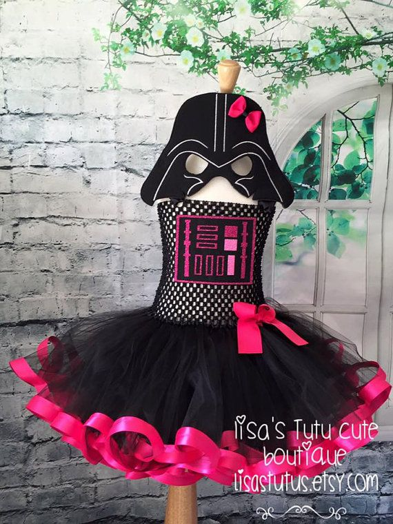 Please read all before purchase.  Give your little girl the treat of a lifetime! Let her celebrate in this Darth Vader inspired tutu dress! Dress comes on a stretch crochet top with attached tutu. Perfect for that birthday celebration, Halloween, or every day dress up! My dresses have been kid tested and mother approved! They can take the hard play! Mask is included  When ordering please order according to your child SIZE, not their age. This will ensure that you receive the correct sized…