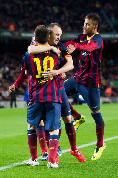 (L-R) Lionel Messi, Andres Iniesta and Neymar Santos Jr of FC Barcelona celebrate after Lionel Messi scored his team's second goal during the La Liga match between FC Barcelona and RC Celta de Vigo at Camp Nou on March 26, 2014 in Barcelona, Catalonia.