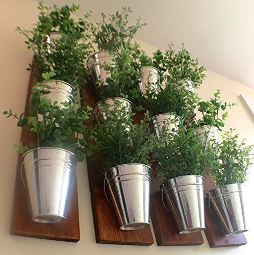 DIY this!  Piece of wood, dollar store tins. There ya go!