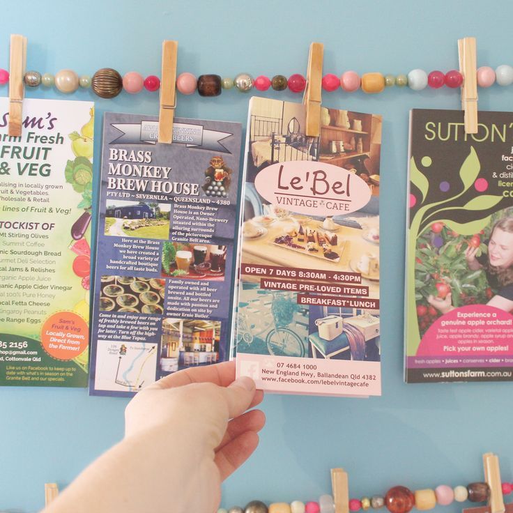 DIY brochure display for our Recycled Gallery made using reclaimed beads, pegs and string. So easy and cute.