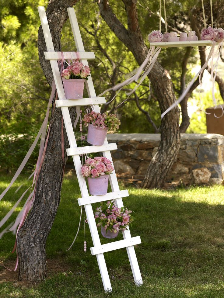 Flowers on a ladder.  http://www.instyle.gr/photo-gallery/roz-vaftisi-koritsiou/