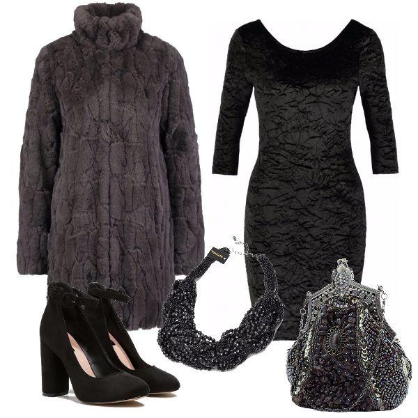 Outfit ideale per un sabato sera fuori con amici o in dolce compagnia. L'effetto cangiante dell'abito in velluto si sposa perfettamente con le consistenze della pelliccia, delle scarpe con tacco scamosciate e dei brillanti accessori in pietre.