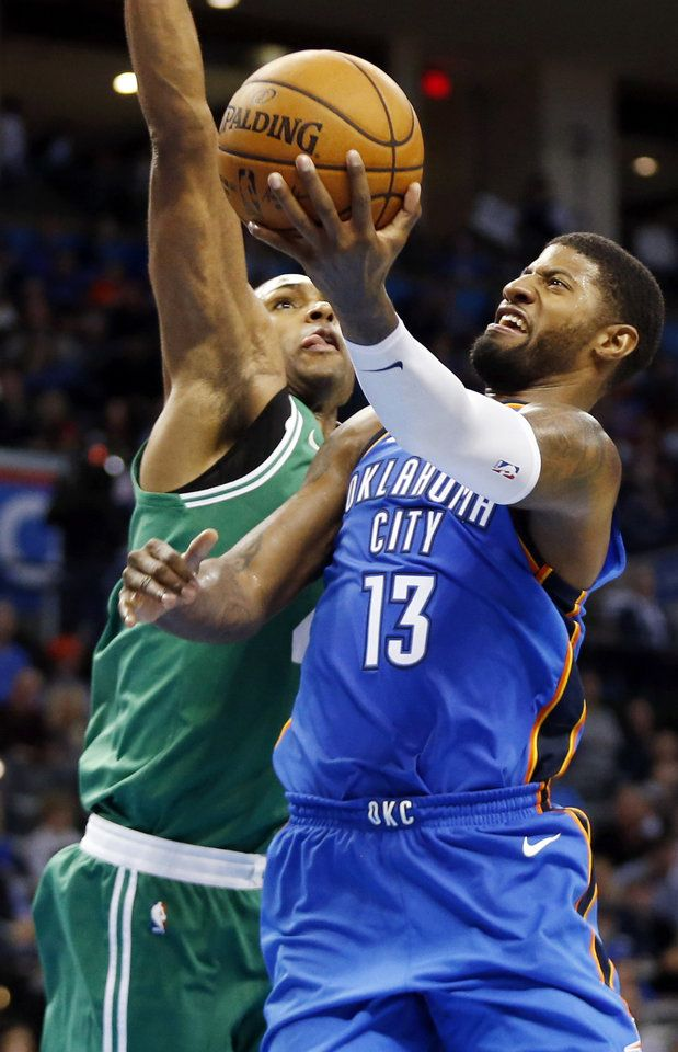 Oklahoma City's Paul George (13) shoots as Boston's Al Horford (42) defends during an NBA basketball game between the Oklahoma City Thunder and the Boston Celtics at Chesapeake Energy Arena in Oklahoma City, Friday, Nov. 3, 2017. Boston won 101-94. Photo by Nate Billings, The Oklahoman
