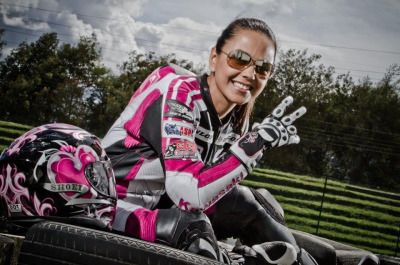 Claudia Gutierrez, in Bogota Colombia, done all up in her pink gear. Photo by George Moreno. (see also previous postings of Claudia in her pink Icon gear riding and hanging out.)