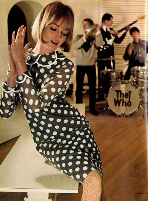 Early 60's fashion shoot with The Who pretending to play in the background. Possible early color printing Would guess date is 1964 /5 before skirts started to go thigh high.