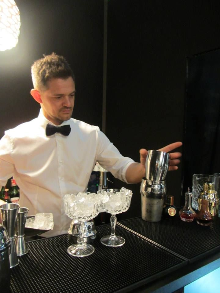 Barman Andrea Cason at VILLA PARENS stand with his signature cocktails.
