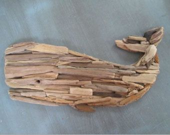 Instant beach decor for any wall! This listing is for a stunning wall hanging driftwood whale. A mosaic pattern of driftwood makes up the entirety of this beautiful piece. All driftwood has been personally selected from the shores of Lake Erie, washed and steam sterilized so no unpleasant odors. A sea blue glass eye completes the charm of this unique piece!  Measures 23 long x 12 tall x 1.5 in depth. Outer circumference is wound with polished hemp to complete the look. Comes pre-assembled…