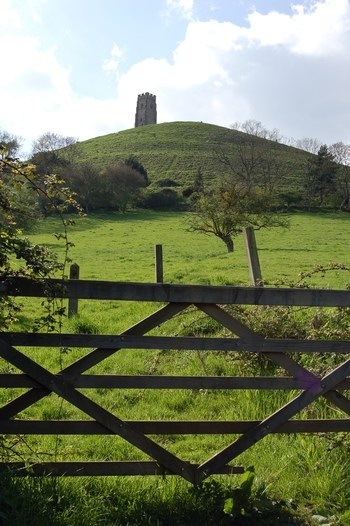 Somerset: Glastonbury Tor, topped with the 15th century St Michael's Tower. Mythical final resting place of King Arthur, home of Gwyn ap Nudd, King of the Fairies ... has had significance since neolithic times and *is* a magical place to visit.