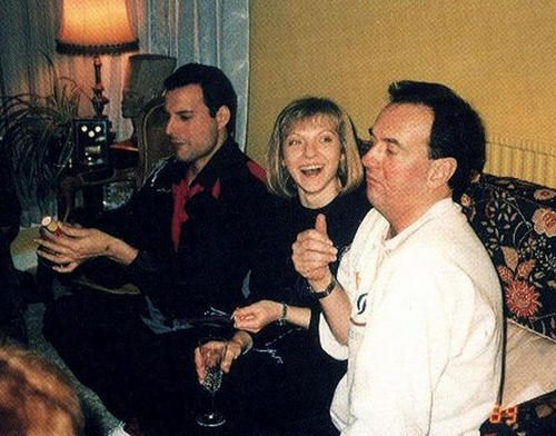 Freddie Mercury and Mary Austin with ?