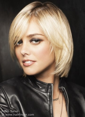 Short Bob in Vanilla: It only took a little bit of layering to make this chin length bob so soft and appealing. It has a feathery and very light texture and utterly flattering lines. A long fringe can be parted on the side and creates an oval frame for her face together with the inward styled sides and their fine tuned tips. The fresh vanilla color adds to the freshness of this adorable fall and winter look.