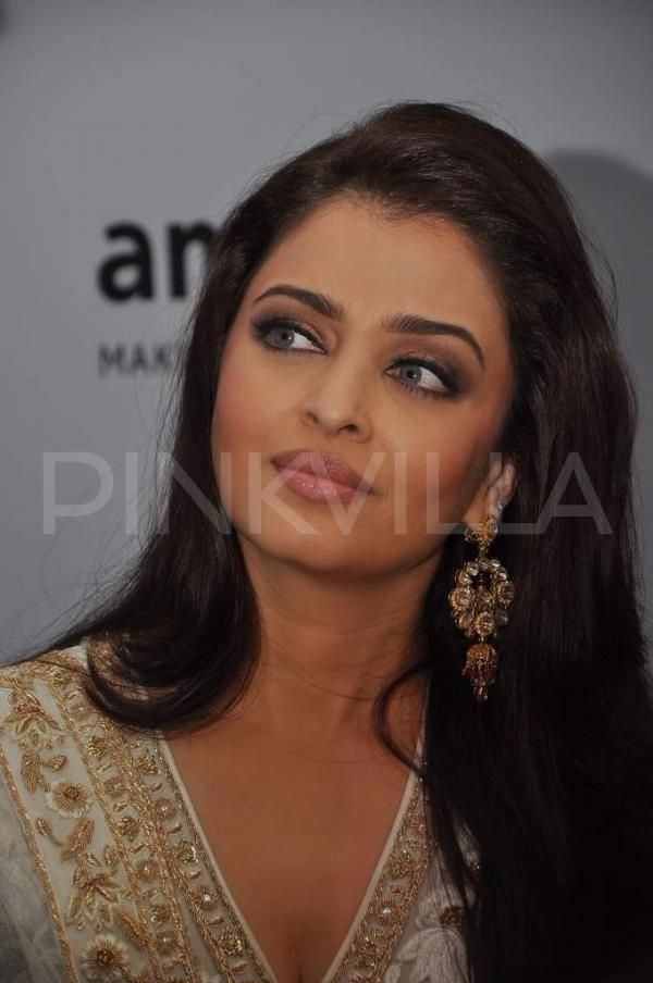 Abhishek and Aishwarya Bachchan hosted the amfAR (The Foundation for AIDS Research) fund-raising event tonight along with the Global Fund raising Chair of amfAR, Sharon Stone. This event took place at Taj Mahal Palace, Mumbai.  Designers Rohit Bal Tarun Tahiliani, and Abu Jani Sandeep Khosla showcased their collections at the Gold Fashion Show in the event which was followed by a performance by pop star Ke$ha. At: @MITTHU AISH Source @Pink Villa