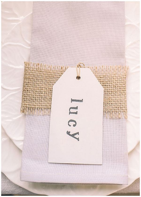 40+ Hessian Wedding Ideas - place settings with hessian ribbon around the napkin and a luggage tag with the guests name stamped on #weddingideas #hessianwedding #rusticweddingideas
