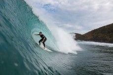 Brtett Wood rides a hollow wave during a surf at a beach in Raglan, Waikato, New Zealand.
