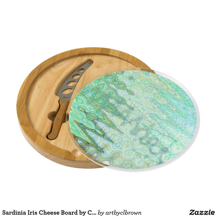 The Sardinia Iris Cheese Board designed by Artist C.L. Brown features an abstract kinetic light painting edited for design in contemporary shades of varied blues, verdant greens, and Etruscan yellows that you'll love. Serve your fine cheeses and hors d'oeuvres on a beautiful, artist-designed cheese board made with a combination of natural wood and bamboo. The Iris is a sleek circular cheese set that comes with a cheese knife that is stored within. So simple and elegant, the Iris adds just…