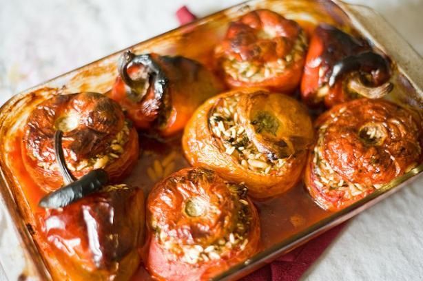 omg...when i was a nanny their Yia Yia used to make these....YUMMMMY: Yemista (Greek Stuffed Tomatoes and Peppers)... leave out or sub cheese for vegan