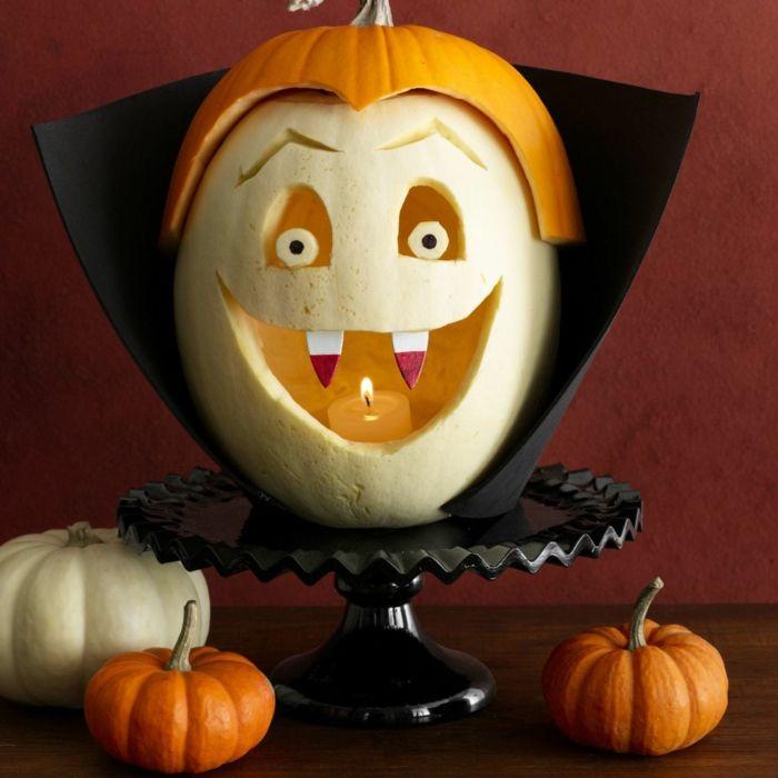 Kürbis schnitzen und verzieren, Dracula Gesicht, DIY Ideen für Kinder und Erwachsene, tolle Halloween Deko