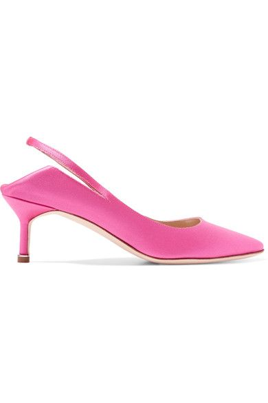 ONLINE EXCLUSIVE AT NET-A-PORTER.COM. Vetements' collaboration with Manolo Blahnik is one of the most eagerly anticipated of recent seasons. These slingback pumps have been handmade in Italy from lustrous bright-pink satin that's backed in leather for the smoothest fit. Rather than cut out, they are folded down at the back to create a slipper effect. Show yours off with ankle-grazing jeans.