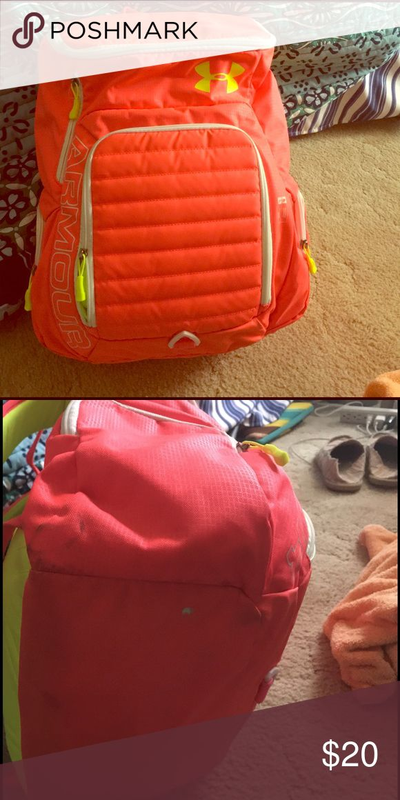 Under armor back pack. Bright coral color Back back is in great condition, except for a stain on the bottom right side of the back pack that could probably be cleaned out. Back pack was used for a gym back and only used on Occ. Under Armour Bags Backpacks