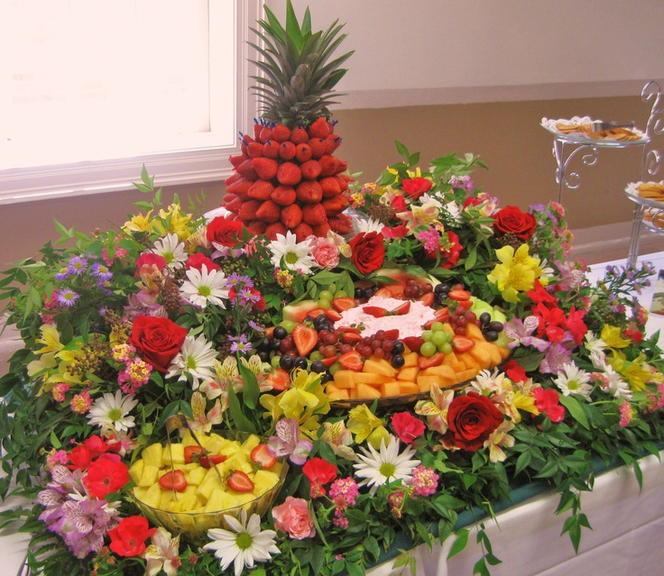Fresh Fruit Cascade With Fresh Flowers And Greenery For An