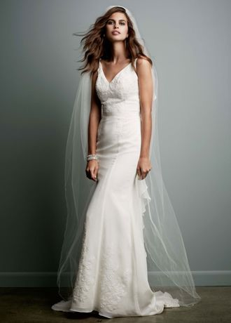 This soft chiffon v-neck wedding dress has all the unique details for any bride wanting to celebrate her style on her walk down the aisle.   This gown is perfect for any girl who wants to make a memorable statement.  Soft sheath gown offers exquisite lace applique details and a gorgeous ruffled back for a textured and dimensional look.  Sweep Train.