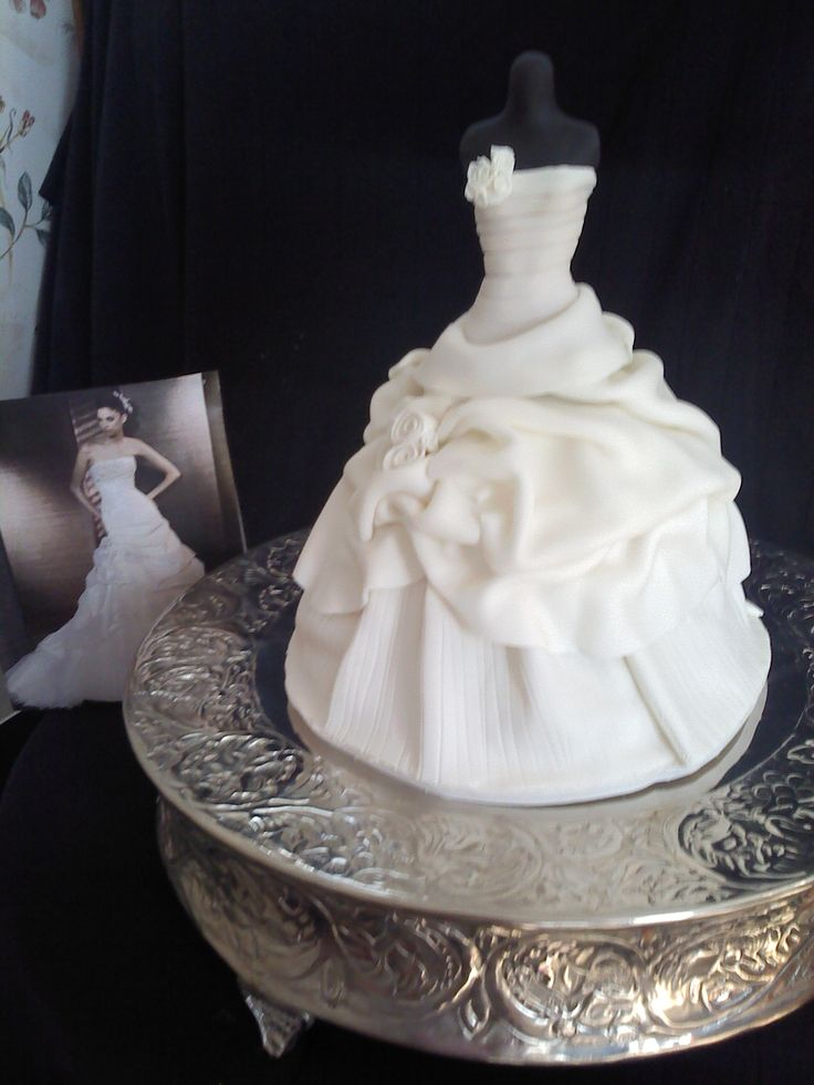 Wedding Dress Cake - Made to replicate the brides dress.  Pound cake underneath, dress form is a dismembered Barbie :/  wrapped in fondant.