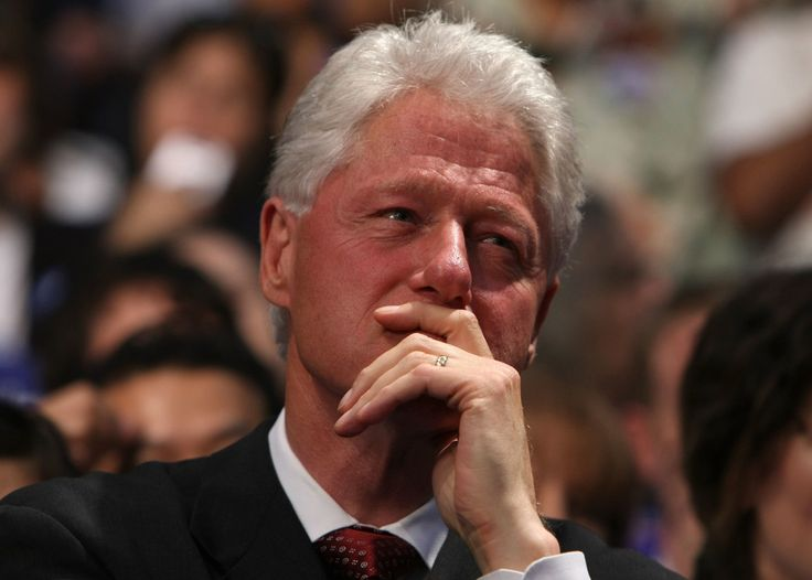 Former President Bill Clinton looks on while his wife, Democratic presidential…
