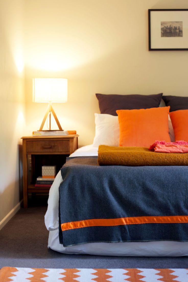 Orange #chevron rug @Amy Pinca. @Freedom New Zealand lamp #orangeandgrey. Styling by Placesandgraces