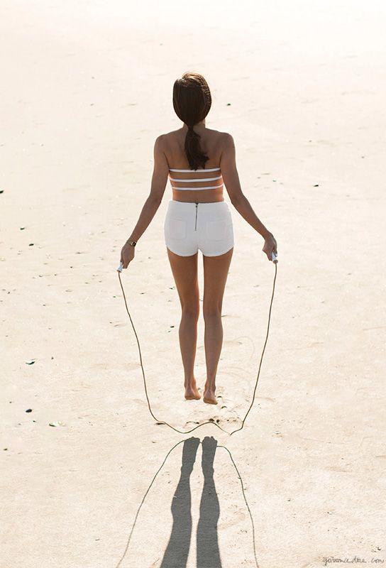 Swimsuit, Mikoh; Shorts, Dolce & Gabbana; Jump Rope, Eres / Garance Doré