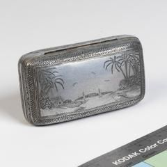 Soap dish engraved with a six inch nail by a disabled prisoner in Changi Prison, Singapore, exchanged for a few cigarettes by Frederick Chamberlain - 1940s.