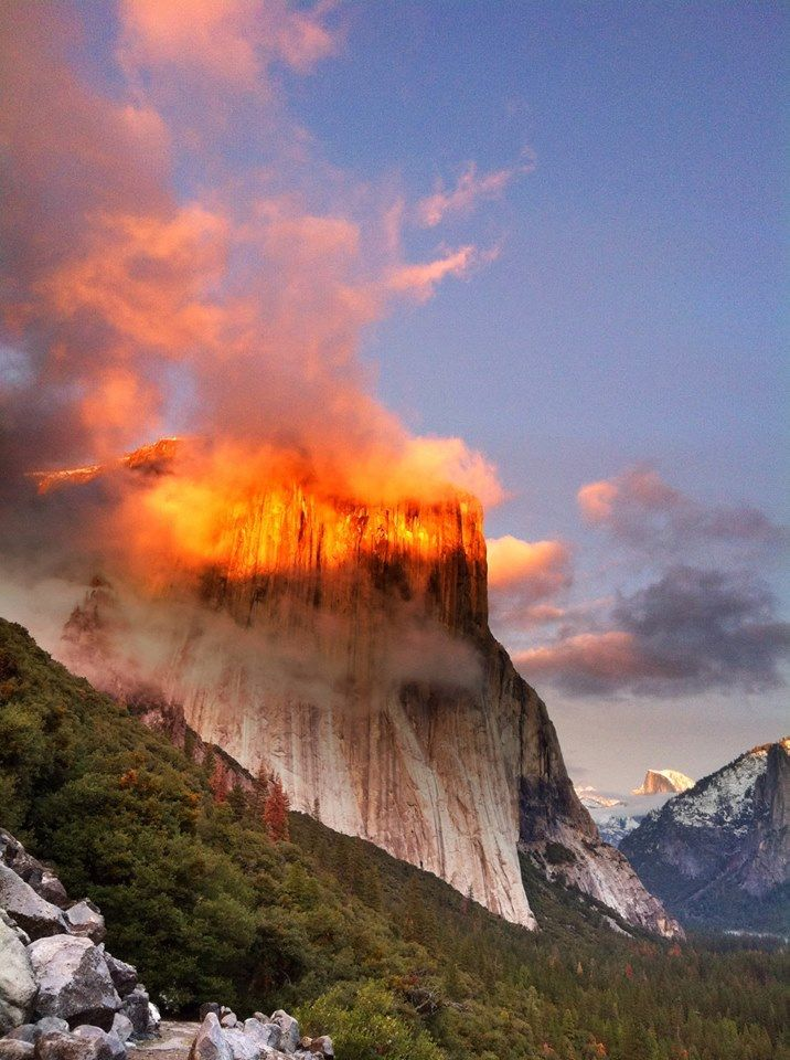 El Capitan in Yosemite National Park (California) glows at sunset. This effect is known as alpenglow, and it commonly occurs Yosemite during the winter months.