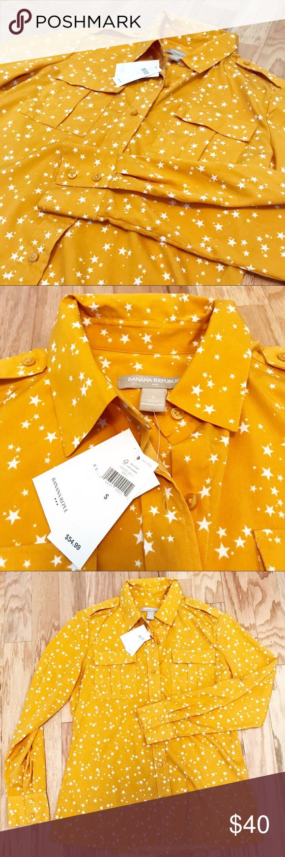 NWT‼️ Banana Republic Button Down Star Mustard Beautiful NWT brand new with tags mustard button up shirt. Military style and absolutely gorgeous gold / golden / mustard color with stars!! ⭐️ stars are cream / white! Top / shirt / blouse that is silky material! Collared sleeves can be worn long or rolled and Button for elbow / 3/4 length starry Banana Republic Tops Button Down Shirts