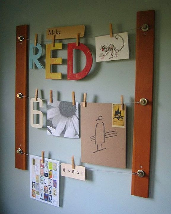 2 pieces of wood, some nuts and bolts, picture hanging wire, and clothespins. make this display/memo wall thing.
