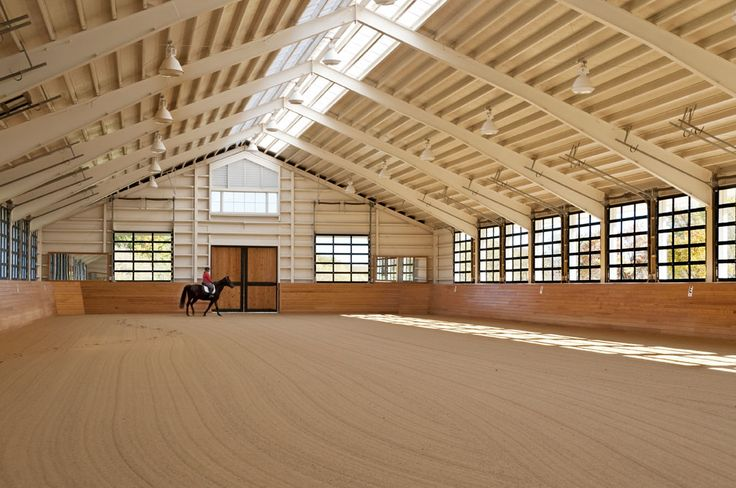 All's Well Farm. So much natural light in an arena! Skylights and windows that are garage doors. They can be opened up on nice days to get some air circulating.