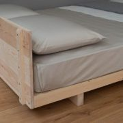 A simple, stylish Japanese bed with headboard. Made in the UK in solid timber, available in a variety of sizes, in pine and hardwoods. Buy online.