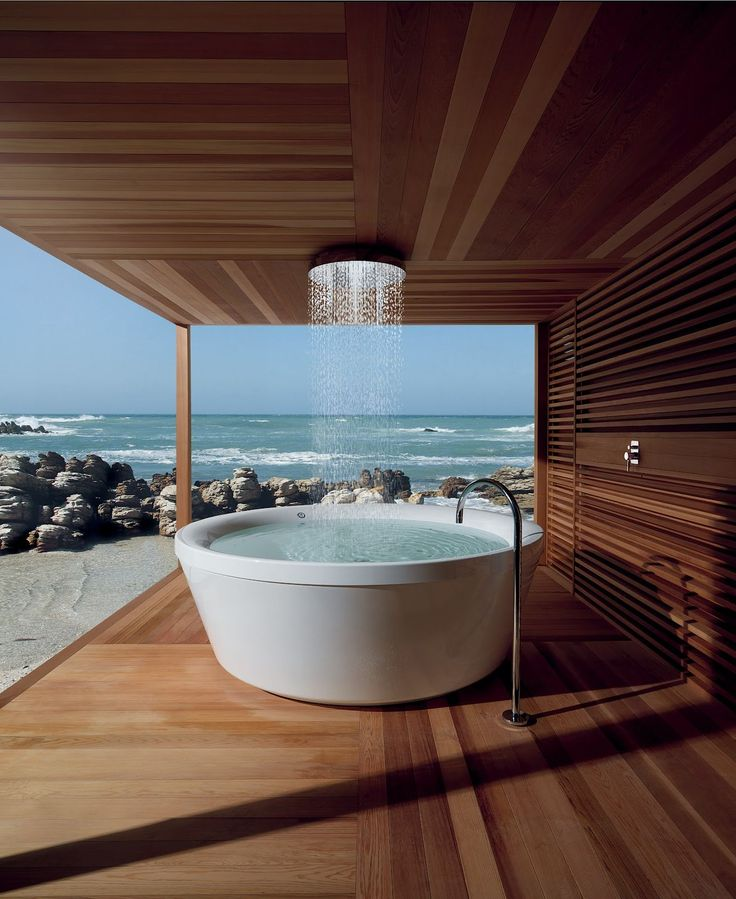 The Art Gallery Outdoor Bathroom Design Ideas with Round Bathtub and Wood Deck And the Ocean view is