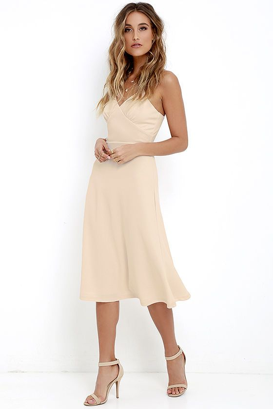 You'll be well on your way to stardom with the On Broadway Beige Midi Dress mesmerizing the crowds! Adjustable spaghetti straps support a triangle bodice (made from textured knit), all atop a set-in waist and full, A-line midi skirt. Hidden back zipper with clasp.