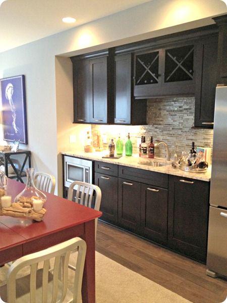 basement kitchenette - dark cabinets, gray wall
