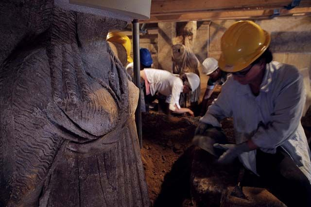 Once the stones were removed and more dirt was cleared, archaeologists could see the female statues in full.