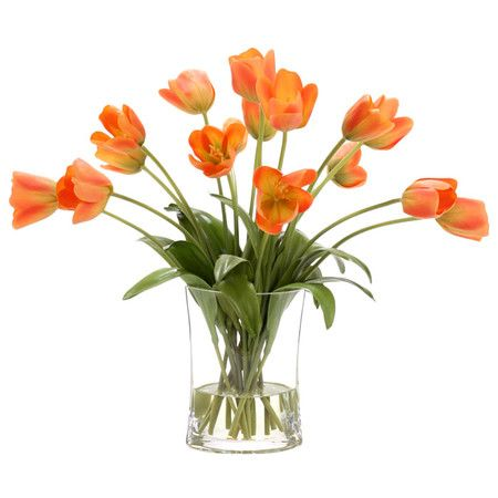Add a touch of garden-inspired elegance to your decor with this faux tulip arrangement, showcasing silk blooms nestled in a glass vase.