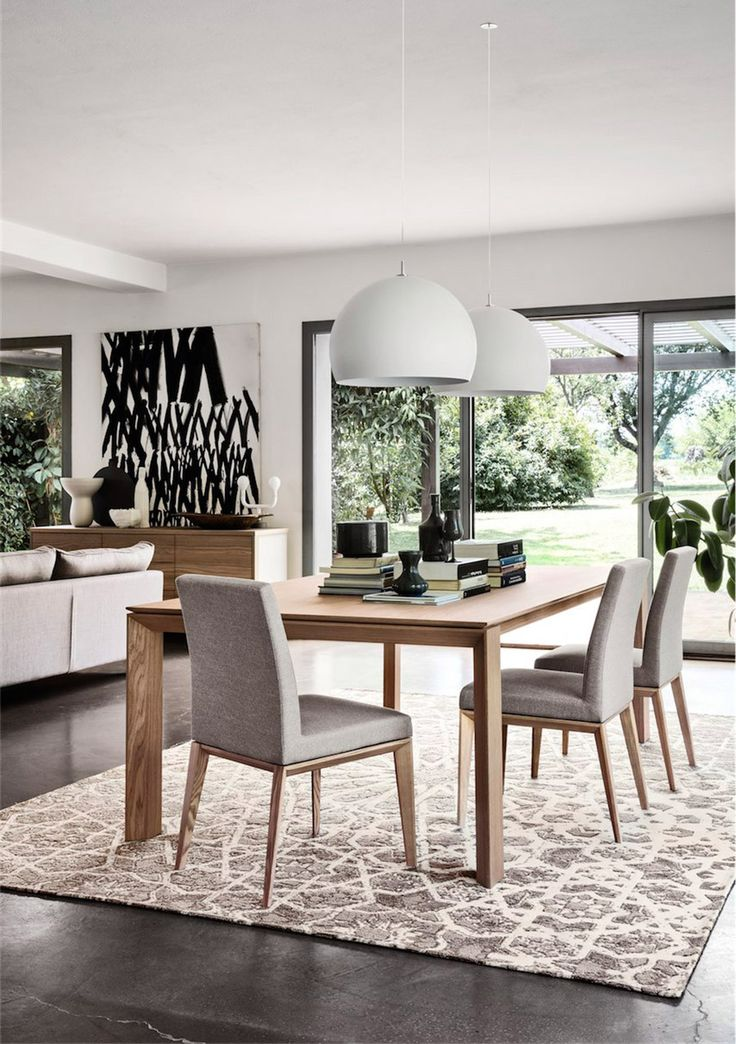 CALLIGARIS | The Omnia dining table is one of our most popular dining tables. Its elegant and sophisticated design suits traditional and modern spaces. Available in various sizes, you can choose to seat from 4 to 12 people. #Designicons #Diningtables #Italianfurniture #Calligaris #Interiordesign