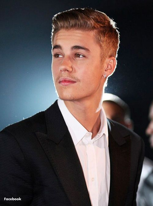 Justin Bieber and Leonardo DiCaprio went mano a mano in a bidding war to capture a stunning aquamarine-and-diamond necklace at the Cannes Film Festival's charity auction to help fund AIDS research. In the end, the 20-year-old pop star prevailed with a winning bid of $545,000. The necklace is for his mom. Much more at our daily blog.