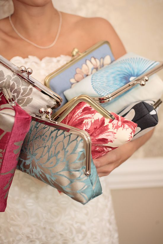 Idea: Clutches for bridesmaids gifts.. fill it with a schedule, thank you notes, lip gloss, disposable camera, and candy to keep the energy up.