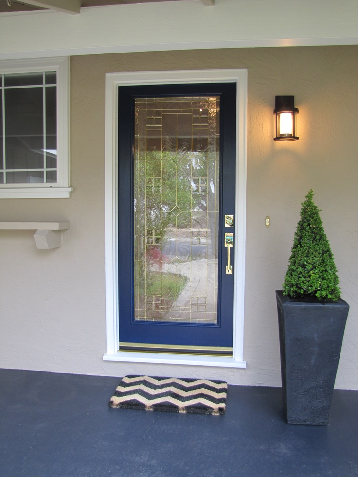 """Redone Home Exterior - House Paint - Body: Wise Owl + 200% by Kelly Moore Door color: """"Naval"""" by Sherwin Williams Porch light - Quentin Pendant Sconce by Restoration Hardware.  Chevron Door Mat by Ballard Designs Concrete Floor stained to a Charcoal Gray"""