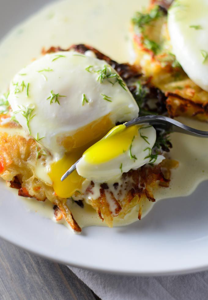 Homemade hash browns topped with Eggs Benedict (poached egg and hollandaise sauce)